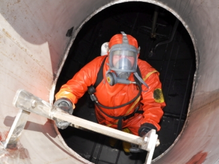 worker entering storage tank.jpg